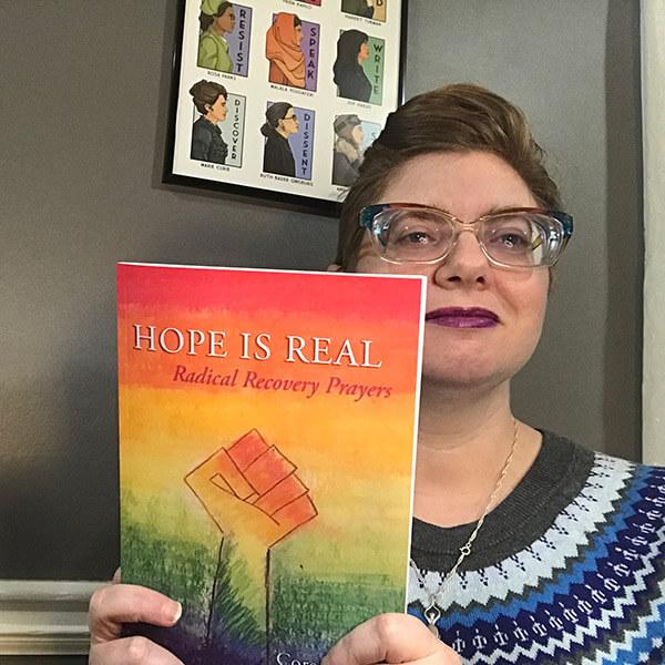 Corey Jones with her book Radical Recovery Prayers